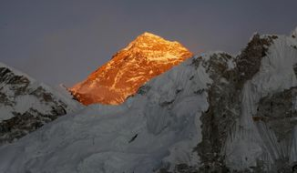FILE - In this Nov. 12, 2015, file photo, Mt. Everest is seen from the way to Kalapatthar in Nepal. An American climber has died near the summit of Mount Everest and an Indian climber is missing after heading down from the mountain following a successful ascent, expedition organizers said Sunday. (AP Photo/Tashi Sherpa, File)