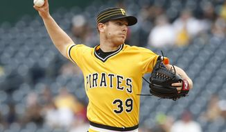 Pittsburgh Pirates starting pitcher Chad Kuhl (39) pitches in the first inning against the Philadelphia Phillies during a baseball game in Pittsburgh, Sunday, May 21, 2017. (AP Photo/Jared Wickerham)