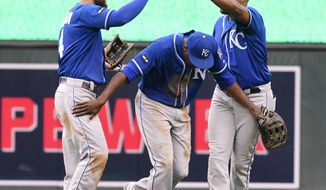 Kansas City Royals center fielder Lorenzo Cain, center, celebrates the Royals 6-4 win against the Minnesota Twins by going under a bridge by left fielder Alex Gordon, left, and right fielder Jorge Bonifacio after the first game of a baseball doubleheader, Sunday, May 21, 2017, in Minneapolis. (AP Photo/Tom Olmscheid)