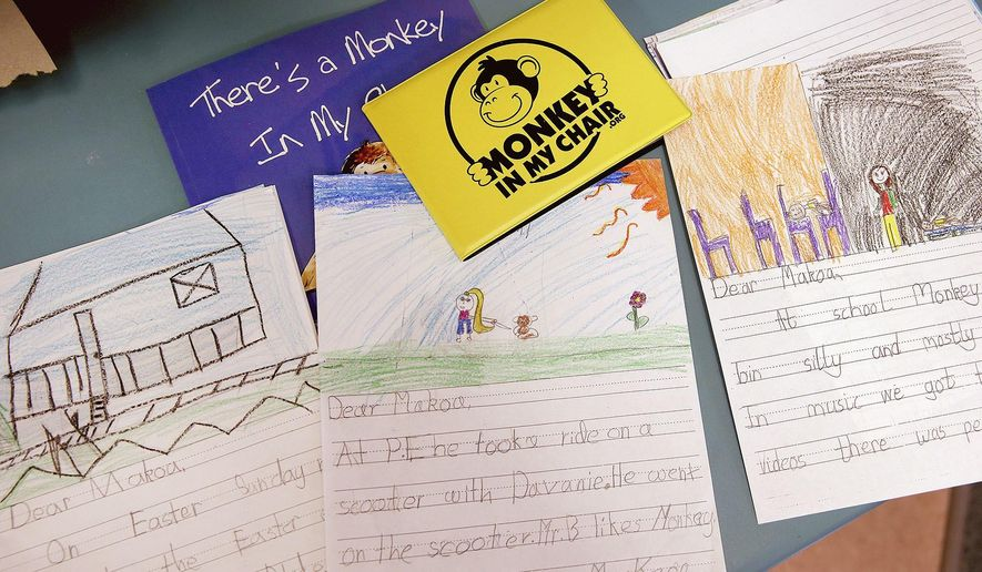 In this Thursday, May 4, 2017 photo, letters written by Richard Gordon Elementary School second grade students to student Makoa Saffery who is suffering from cancer are displayed in Kingston, Wash. Makoa Saffery, 8, is out to beat cancer. In treatment at Mary Bridge Children's Hospital in Tacoma since February, Makoa is strong, upbeat and determined.  (Larry Steagall/Kitsap Sun via AP)
