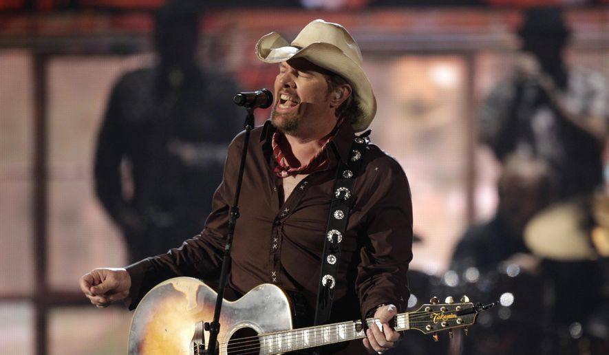 In this April 3, 2011 file photo, American country singer, Toby Keith performs at the 46th Annual Academy of Country Music Awards in Las Vegas, CA. (AP Photo/Julie Jacobson, File)  **FILE**
