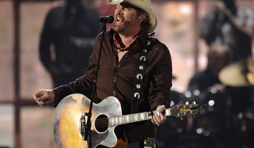 "FILE -- In this April 3, 2011 file photo, American country singer, Toby Keith performs at the 46th Annual Academy of Country Music Awards in Las Vegas, CA. Keith, known for songs such as ""Whiskey Girl"" and ""Beer For My Horses,"" is scheduled to perform in the Saudi capital, Riyadh, Saturday, May 20, 2017,  in an event that coincides with President Donald Trump's first overseas visit. Saudi entertainment website Lammt, which is advertising the event, says the free concert, which will also feature an Arabian lute player, is open to men only. (AP Photo/Julie Jacobson, File)"