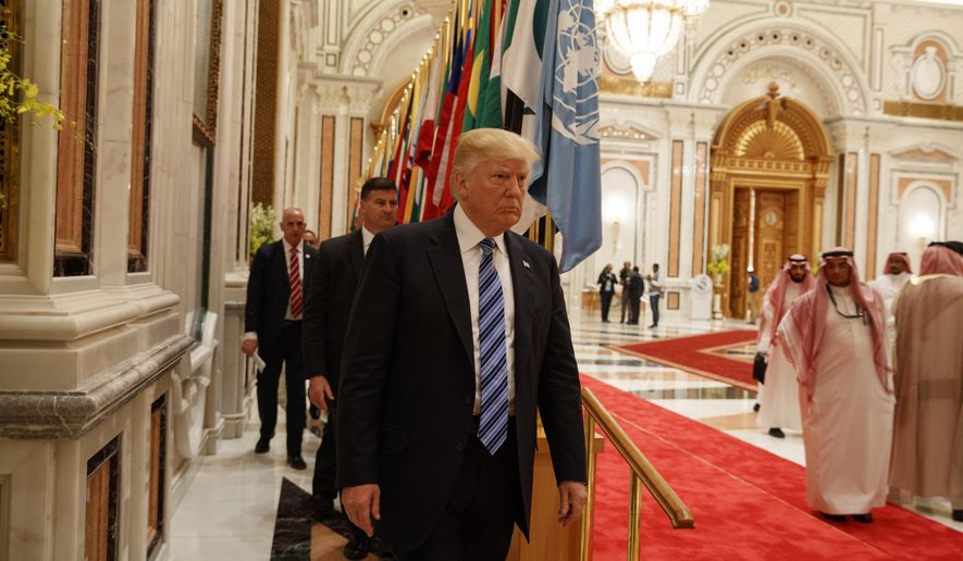 President Donald Trump arrives to deliver a speech to the Arab Islamic American Summit, at the King Abdulaziz Conference Center, Sunday, May 21, 2017, in Riyadh, Saudi Arabia. (AP Photo/Evan Vucci)