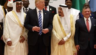 President Donald Trump talks with Saudi King Salman as they pose for photos with leaders at the Arab Islamic American Summit, at the King Abdulaziz Conference Center, Sunday, May 21, 2017, in Riyadh, Saudi Arabia. Jordan's King Abdallah II stands at right. (AP Photo/Evan Vucci)