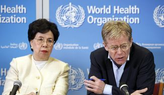In this Tuesday, March 29, 2016, file photo, Margaret Chan, left, General Director of the World Health Organization (WHO), and Bruce Aylward, right, Executive Director of WHO and Health Emergencies Director-General's Special Representative for the Ebola Response, speak to the media after The International Health Regulations Emergency Committee on Ebola, during a press conference, at the WHO headquarters in Geneva, Switzerland. The World Health Organization routinely spends about $200 million a year on travel, far more than what it doles out to fight some of the biggest problems in public health including AIDS, tuberculosis and malaria, according to internal documents obtained by The Associated Press, published Sunday, May 21, 2017. (Salvatore Di Nolfi/Keystone via AP, File)