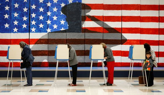 Voters cast their ballots before a patriotic mural in Richmond, Virginia. (Associated Press)