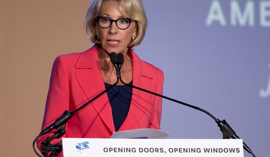 "Education Secretary Betsy DeVos speaks at a summit hosted by American Federation for Children in Indianapolis, Monday, May 22, 2017. DeVos said the Donald Trump administration is proposing ""the most ambitious expansion"" of school choice in American history. (Robert Scheer/The Indianapolis Star via AP)"