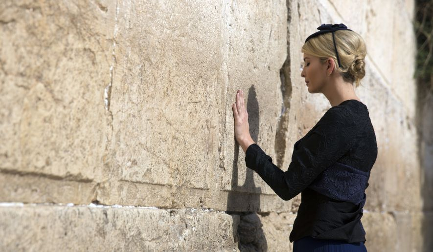 Ivanka Trump touches the Western Wall, Judaism's holiest prayer site, in Jerusalem's Old City Monday,May 22, 2017. (Heidi Levine, pool via AP)