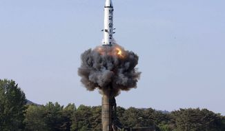 """In this Monday, May 22, 2017, photo distributed by the North Korean government, a solid-fuel """"Pukguksong-2"""" missile lifts off during its launch test at an undisclosed location in North Korea. North Korea fired a solid-fuel ballistic missile Sunday that can be harder for outsiders to detect before launch and later said the test was hailed as perfect by leader Kim Jong Un. The official Korean Central News Agency confirmed Monday the missile was a Pukguksong-2, a medium-to-long range ballistic missile also launched in February. The missile flew about 500 kilometers (310 miles) and reached a height of 560 kilometers (350 miles) Sunday before plunging into the Pacific Ocean. Independent journalists were not given access to cover the event depicted in this photo. (Korean Central News Agency/Korea News Service via AP)"""