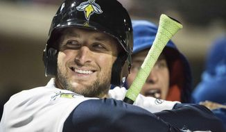 FILE - In April 6, 2017, file photo, Columbia Fireflies outfielder Tim Tebow smiles during a Class A minor league baseball game against the Augusta GreenJackets in Columbia, S.C. Tebow may have found his hitting groove once more with his third home run of the season - and first in six weeks - for the Columbia Fireflies. The former NFL quarterback and Heisman Trophy winner had struggled at the plate much of the week before ending an 0-for-18 slump with an RBI double on Saturday, May 20. (AP Photo/Sean Rayford, File)