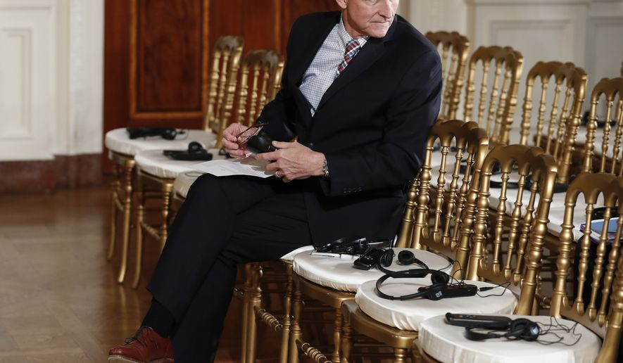 """In this photo taken Feb. 10, 2017, then-National Security Adviser Michael Flynn sits in the front row in the East Room of the White House, in Washington. Attorneys for Flynn say that a daily """"escalating public frenzy against him"""" and the Justice Department's appointment of a special counsel has created a legally dangerous environment for him to cooperate with a Senate investigation. That's according to a letter obtained by The Associated Press sent Monday by Flynn's legal team to the Senate Intelligence committee. It lays out the case for Flynn, the former national security adviser, to invoke his right against self-incrimination. (AP Photo/Carolyn Kaster)"""