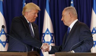 President Donald Trump shakes hands with Israeli Prime Minister Benjamin Netanyahu after making joint statements, Monday, May 22, 2017, in Jerusalem. (AP Photo/Evan Vucci)