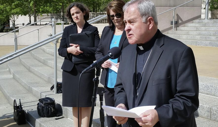 "St. Louis Archbishop Robert Carlson speaks at a news conference Monday, May 22, 2017, announcing a federal lawsuit to stop a St. Louis ordinance that prohibits discrimination based on ""reproductive health decisions."" The suit says the law enacted in February infringes on freedom of religion rights of those who oppose abortion. Behind Carlson are attorney Sarah Pitlyk, left, of the Thomas More Society, a non-profit law firm that filed the suit, and Peggy Forrest, executive director of Our Lady's Inn, which provides services for pregnant women who are homeless and is a plaintiff in the lawsuit. (AP Photo/Jim Salter)"
