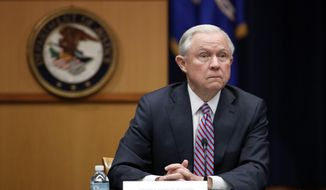 """This Department of Justice will continue to vigorously defend the power and duty of the Executive Branch to protect the people of this country from danger, and will seek review of this case in the United States Supreme Court,"" said Attorney General Jeff Sessions in a statement issued Thursday. (Associated Press/File)"