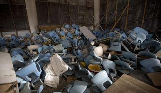 """FILE - This Feb. 2, 2017 file photo shows seats jumbled in a pile inside Maracana stadium, the historic stadium, site of the opening and closing ceremony, in Rio de Janeiro, Brazil. A federal prosecutor looking into last year's Rio de Janeiro Olympics says many of the venues """"are white elephants"""" that were built with """"no planning."""" The scathing report offered Monday, May 22, 2017,  at a public hearing confirms what The Associated Press reported several months after the games ended. Many of the venues are empty, boarded up, and have no tenants or income with the maintenance costs dumped on the federal government.(AP Photo/Silvia Izquierdo, File)"""