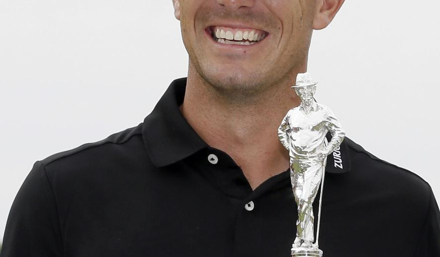 Billy Horschel poses with the trophy after winning the Byron Nelson golf tournament, Sunday, May 21, 2017, in Irving, Texas. (AP Photo/Tony Gutierrez)