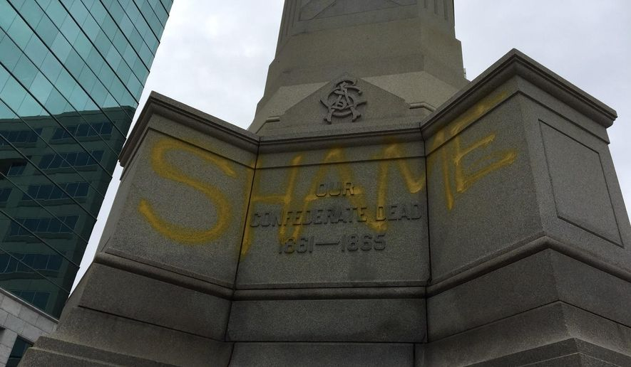 "A word ""SHAME"" is is spray-painted on the Confederate monument located downtown on East Main Street in Norfolk, Va., on Monday, May 22, 2017. The Norfolk City Council decided in 2015 to keep the monument, despite pressure from a local civil rights group. (Lee Tolliver /The Virginian-Pilot via AP)"