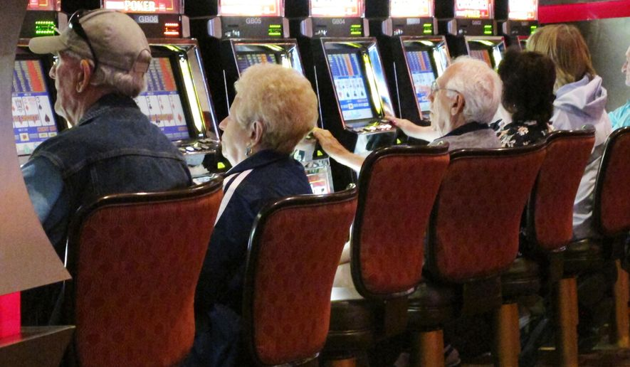 In this June 24, 2016 photo gamblers play slot machines at the Golden Nugget casino in Atlantic City, N.J. Figures released on Monday, May 22, 2017 show Atlantic City's seven casinos saw their gross operating profit increase by more than 30 percent in the first quarter of 2017 compared with the same period a year ago. (AP Photo/Wayne Parry)