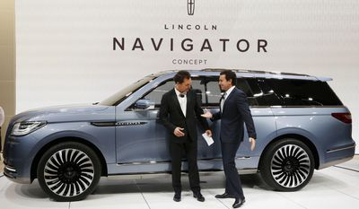 FILE - In this March 23, 2016 file photo, actor Matthew McConaughey, left, and Ford CEO Mark Fields introduce the Lincoln Navigator Concept at the New York International Auto Show. Ford is replacing its CEO amid questions about its current performance and future strategy, a person familiar with the situation has said. Fields will be replaced by Jim Hackett, who joined Ford's board in 2013. (AP Photo/Mark Lennihan, File)