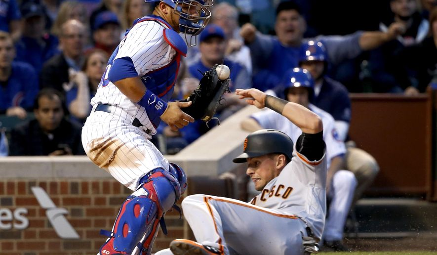 San Francisco Giants' Joe Panik, right, scores in front of Chicago Cubs catcher Willson Contreras on a single by Brandon Belt, during the third inning of a baseball game against the Chicago Cubs, Monday, May 22, 2017, in Chicago. (AP Photo/Charles Rex Arbogast)
