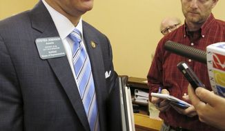 Kansas House Taxation Committee Chairman Steven Johnson, R-Assaria, answers questions from reporters as he and other House members prepare to restart talks with the Senate over raising taxes to fix the state budget, Monday, May 22, 2017, at the Statehouse in Topeka, Kan. Lawmakers are struggling to agree on tax proposals. (AP Photo/John Hanna)