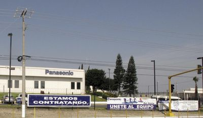 "This April 28, 2017 photo shows a sign that says ""We're hiring"" outside a Panasonic ""maquiladora"" in an industrial park in Reynosa, Mexico, across the border from McAllen, Texas. A long-time factory worker said he worried that if maquila jobs decrease, the unemployed would fill the ranks of a drug cartels that control Mexican border towns. (AP Photo/Christopher Sherman)"
