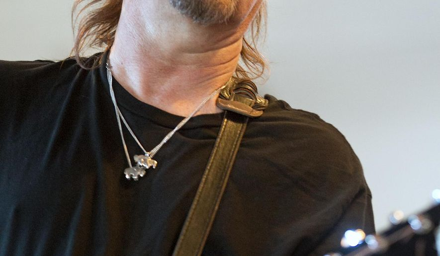 In this Sept. 17, 2012, photo, Singer-songwriter Jimmy LaFave plays during an in-store performance at Waterloo Records in Austin, Texas. A statement Monday, May 22, 2017, from Music Road Records says LaFave died Sunday at his Austin home after a fight with cancer. He was 61. (Laura Skelding/Austin American-Statesman via AP)