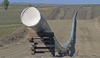 FILE - This Sept. 29, 2016, file photo, shows a section of the Dakota Access pipeline under construction near St. Anthony in Morton County, N.D. The Dakota Access pipeline system leaked about 100 gallons of oil in western North Dakota in two separate incidents in March as crews worked to get the four-state line ready for operation. They're the second and third known leaks on the disputed $3.8 billion pipeline.  (Tom Stromme/The Bismarck Tribune via AP, File)