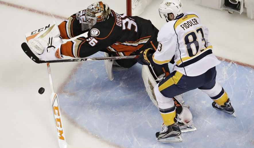 Anaheim Ducks goalie John Gibson (36) vies for the puck with Nashville Predators center Vernon Fiddler during the first period of Game 5 in the NHL hockey Stanley Cup Western Conference finals in Anaheim, Calif., Saturday, May 20, 2017. (AP Photo/Chris Carlson)