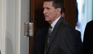 The Senate investigators are subpoenaing his businesses' records of former National Security Adviser Michael Flynn. (AP Photo/Evan Vucci, File)