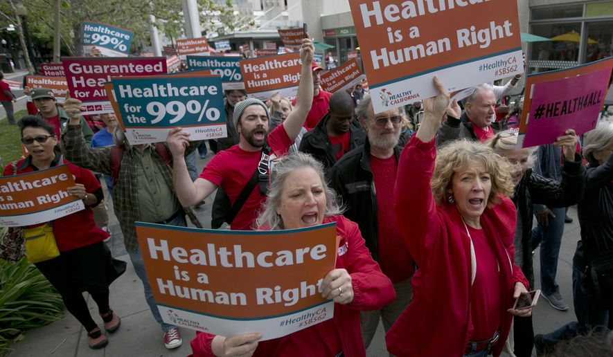 FILE--In this April 26, 2017, file photo, supporters of single-payer health care march to the Capitol in Sacramento, Calif. State experts say a California bill that would provide government-funded health coverage for everyone in the state would cost $400 billion and require significant tax increases. (AP Photo/Rich Pedroncelli, file)