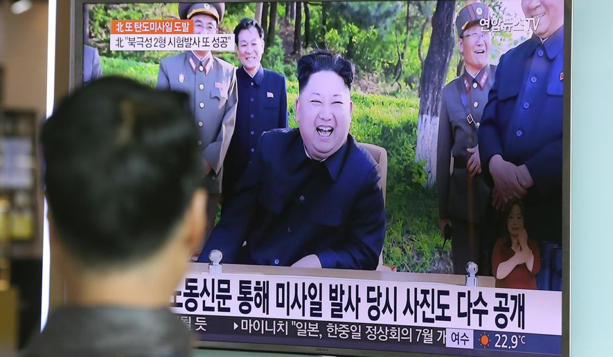 A man watches a TV news program showing image of North Korean leader Kim Jong-un, published in the North Korea's Rodong Sinmun newspaper, at Seoul Railway station in Seoul, South Korea, Monday, May 22, 2017. North Korea fired a solid-fuel ballistic missile Sunday that can be harder for outsiders to detect before launch and later said the test was hailed as perfect by leader Kim Jong-un. (AP Photo/Lee Jin-man)