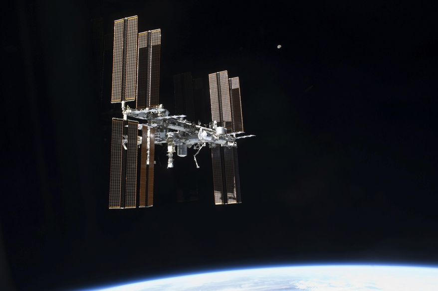 This July 19, 2011 photo of the International Space Station was taken from the space shuttleAtlantis after it left the orbiting complex. NASA ordered up urgent spacewalking repairs at the International Space Station. On Tuesday, May 23, 2017, Americans Peggy Whitson and Jack Fischer will venture out to replace a data relay box that broke over the weekend. (NASA via AP)