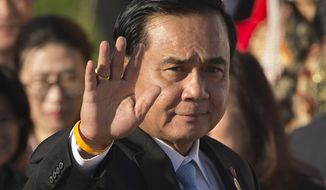FILE - In this July 16, 2016, file photo, Thailand's Prime Minister Prayuth Chan-ocha waves as he arrives for a group photo of leaders at the 11th Asia-Europe Meeting (ASEM) in Ulaanbaatar, Mongolia. Three years after military leaders, led by then junta leader Prayuth, overthrew a democratically elected government in Thailand, the country is sputtering economically, watched closely for its crackdown on political freedom and still the site of sporadic but unnerving unrest. On Monday, May 22, 2017, a bomb exploded in a military-run hospital in the Thai capital, wounding 21 people on the third anniversary of the 2014 coup. (AP Photo/Mark Schiefelbein, File)