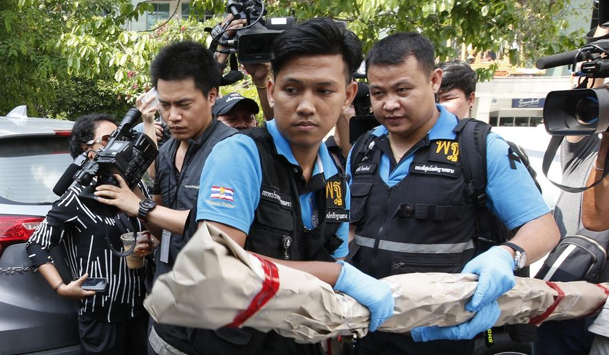 Thai forensic officers carry out collected evidence from Phramongkutklao Hospital, a military-owned hospital that is also open to civilians, in Bangkok after a bomb wounded more than 20 people, in Bangkok Monday, May 22, 2017. The deputy commissioner of the Royal Thai Police said investigators found traces of batteries and wires at the scene Monday. (AP Photo/Sakchai Lalit)