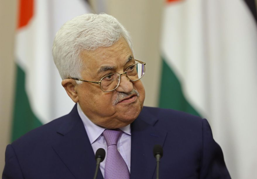 FILE - In a Thursday, May 11, 2017 file photo, Palestinian President Mahmoud Abbas speaks at a joint press conference with Russian President Vladimir Putin at the Bocharov Ruchei residence in the Black Sea resort of Sochi, Russia. Trump son-in-law Jared Kushner and longtime business lawyer Jason Greenblatt were to accompany Trump on his visit, set to begin Monday, May 22, and include separate meetings with Israeli Prime Minister Benjamin Netanyahu and Palestinian Authority President Mahmoud Abbas.(Yuri Kochetkov/Pool photo via AP, File)