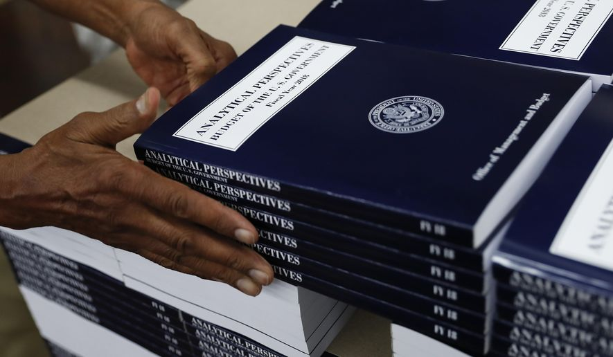 """In this photo taken May 19, 2017, a GPO worker stacks copies of """"Analytical Perspectives Budget of the U.S. Government Fiscal Year 2018"""" onto a pallet at the U.S. Government Publishing Office's (GPO) plant in Washington. (AP Photo/Carolyn Kaster)"""