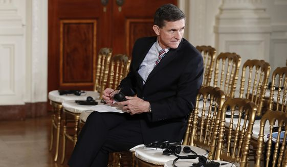 In this photo taken Feb. 10, 2017, then-National Security Adviser Michael Flynn sits in the front row in the East Room of the White House, in Washington. (AP Photo/Carolyn Kaster) ** FILE **