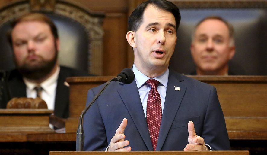 FILE - In this Feb. 8, 2017, file photo, Wisconsin Gov. Scott Walker delivers his state budget address at the Capitol in Madison, Wis. Walker is continuing to put pressure on fellow Republicans in the Legislature not to raise taxes. Walker on Friday, May 19 promised to veto the entire budget if it results in a net property tax increase to homeowners. And on Monday he fired off a series of tweets defending his budget as the GOP-controlled Legislature continues working on making changes to it. (John Hart/Wisconsin State Journal via AP, File)