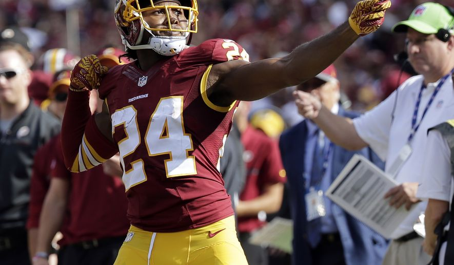 "FILE - In this Oct. 2, 2016, file photo, Washington Redskins cornerback Josh Norman (24) celebrates his interception with a ""bow and arrow,"" gesture during the second half of an NFL football game against the Cleveland Browns in Landover, Md. The NFL wants to put some flair back into celebrations, allowing players to use the football as a prop, celebrate as a group and roll around on the ground again if they choose. The league, however, will continue to penalize any celebration deemed offensive, including those that embarrass opponents or mimic the use of weapons. (AP Photo/Chuck Burton, File)"