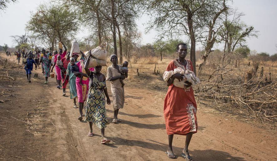 "In this Wednesday, April 5, 2017, file photo, some of thousands of people walk for hours to reach a food distribution site in Malualkuel, in the Northern Bahr el Ghazal region of South Sudan. The new American director of the World Food Program, David Beasley, called the suffering in South Sudan's famine ""deplorable"" as he visited the country Tuesday, May 23, 2017, and called on the government to allow aid groups safe access. (AP Photo, File)"