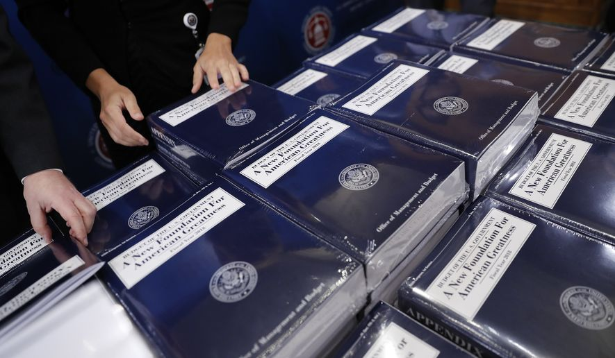 Senate Budget Committee staff members lay out copies of President Donald Trump's fiscal 2018 federal budget for distribution on Capitol Hill in Washington, Tuesday, May 23, 2017. (AP Photo/Pablo Martinez Monsivais)