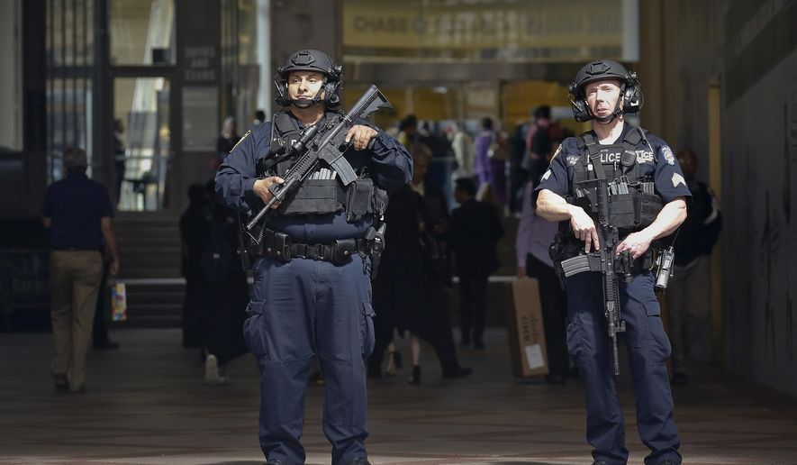 "A New York Police Department anti-terror unit guard an entry area to Madison Square Garden, Tuesday May 23, 2017, in New York. The NYPD says it has tightened security at high-profile locations ""out of an abundance of caution"" following the deadly explosion in Manchester, England.(AP Photo/Bebeto Matthews)"