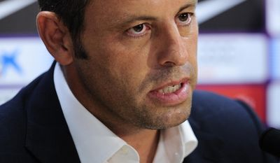 FILE - In this July 19, 2013 file photo, FC Barcelona's president Sandro Rosell attends a press conference at the Sports Center FC Barcelona Joan Gamper in San Joan Despi, Spain. Spanish authorities say former Barcelona president Sandro Rosell and his wife have been detained on May 23, 2017 in a probe over his businesses in Brazil which is part of a money laundering investigation. (AP Photo/Manu Fernandez, File)