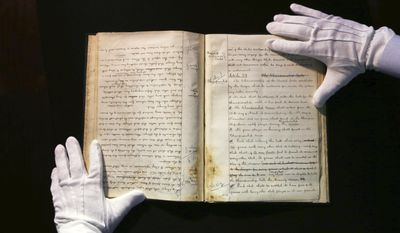 This May 18, 2017, photo shows the hands of SCP Auctions vice president Dan Imler holding the 1876 constitution that founded the National League and the modern business of big league sports, that is going up for sale at SCP Auctions in Laguna Niguel, Calif. Theses pages have corrections and strikeouts, showing that the documents were very much living works in progress. SCP Auctions expects the papers to draw millions when the auction starts Wednesday, May 24. (AP Photo/Reed Saxon)