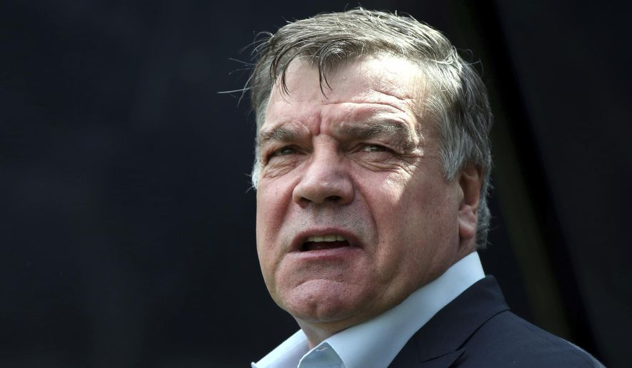 FILE - In this Sunday, May 24, 2015 file photo, Sam Allardyce waits at the start of their English Premier League soccer match between Newcastle United and West Ham United's at St James' Park, Newcastle, England. Crystal Palace manager Sam Allardyce says he is leaving the club after just five months and does not plan to continue his 26-year career in coaching. The 62-year-old Allardyce, who established his Premier League credentials during an eight-year spell with Bolton Wanderers, said in a statement on Tuesday, May 23, 2017 that he was leaving Palace for entirely personal reasons. (AP Photo/Scott Heppell, file)