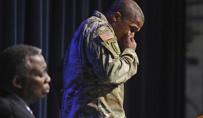 Lt. Col. Joel Thomas, professor of Military Sciences, wipes tears from his face while memorializing Richard Collins III during a memorial vigil for Collins, who was killed Saturday at the University of Maryland in College Park, as they gather at Bowie State's auditorium in Bowie, Md., Monday, May 22, 2017. Authorities appealed for patience Monday from two college communities reacting in shock, fear and anger after a white University of Maryland student was arrested in what police called the unprovoked stabbing of a black Bowie State University student. Collins was commissioned into the Army from the college's ROTC program. (Kenneth K. Lam/The Baltimore Sun via AP)