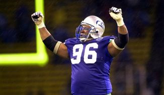 FILE - In this Dec. 16, 2000, file photo, Seattle Seahawks defensive tackle Cortez Kennedy (96) celebrates Seattle's 27-24 victory over the Oakland Raiders in an NFL football game in Seattle. The Orlando Police Department confirmed that Kennedy was found dead Tuesday, May 23, 2017, in Orlando. (AP Photo/Cheryl Hatch, File)