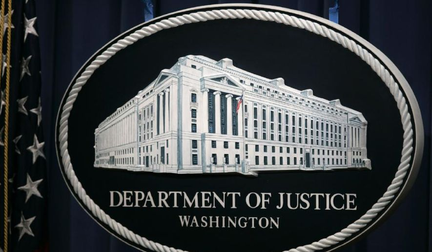 A placard for the Department of Justice's press briefing room is shown here. (Daily Chronic) [http://www.thedailychronic.net/wp-content/uploads/2015/04/Department-of-Justice-Washington.jpg]