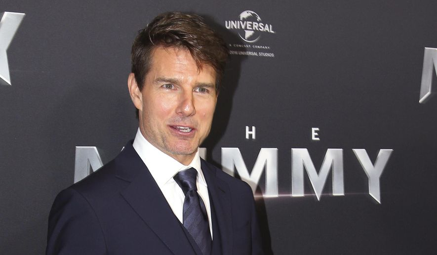 "In this May 22, 2017, file photo, actor Tom Cruise arrives for the Australian premiere of his movie ""The Mummy"" in Sydney, Australia. Universal Studios announced on May 25 that the planned London premiere, scheduled for June 1, was being canceled out of respect for the victim's of the deadly May 22 Manchester terrorist bombing.  (AP Photo/Rick Rycroft, File) **FILE**"